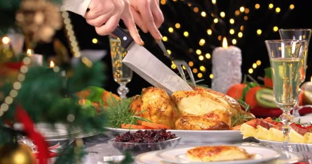 Woman hands carving roasted chicken on Christmas dinner near Christmas tree. 4k