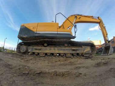 Industrial excavator for ground works in outdoors construction site