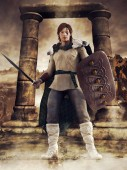 Photo Fantasy Celtic warrior with a sword and a shield standing in front of a stone arch. 3D render.