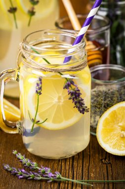Cold Lemonade Infused Detox Water with Lemon and Lavender. Selective focus.