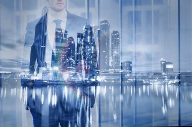 double exposure of businessman with modern city skyline, business background