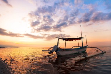 sunset on the beach in Bali, traditional fisherman boat in Indonesia, Lovina