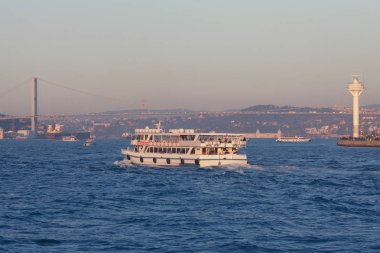 View to European and Asian parts of Istanbul, suspension bridge through Bosphorus strait from Marmara Sea. Evening time, sunny day. Outdoor shot