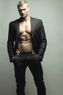 Male fashion concept. Portrait of handsome muscular male model