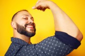 We can do it concept. Close up portrait of charismatic mature man showing his bicep