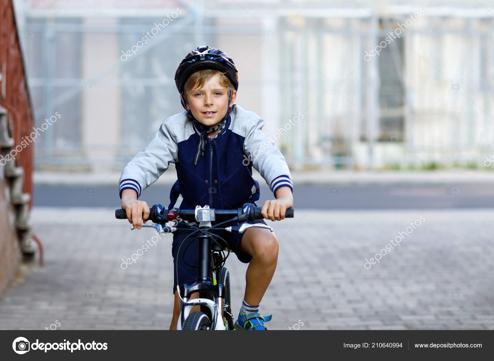 Schoolkid Boy In Safety Helmet Riding With Bike In The City With Backpack Happy Child In Colorful Clothes Biking On Bicycle On Way To School Safe Way For Kids Outdoors To School