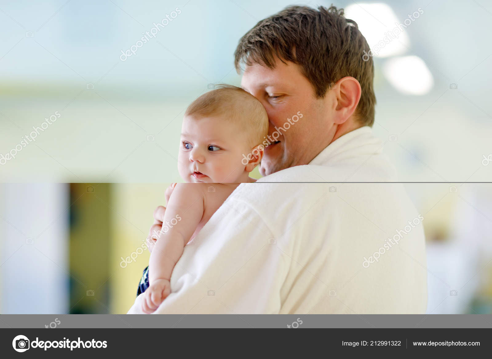 Young father and his little cute newborn baby daughter together in spa hotel dad in white bathrobe holding child adorable girl on arms family relaxing in