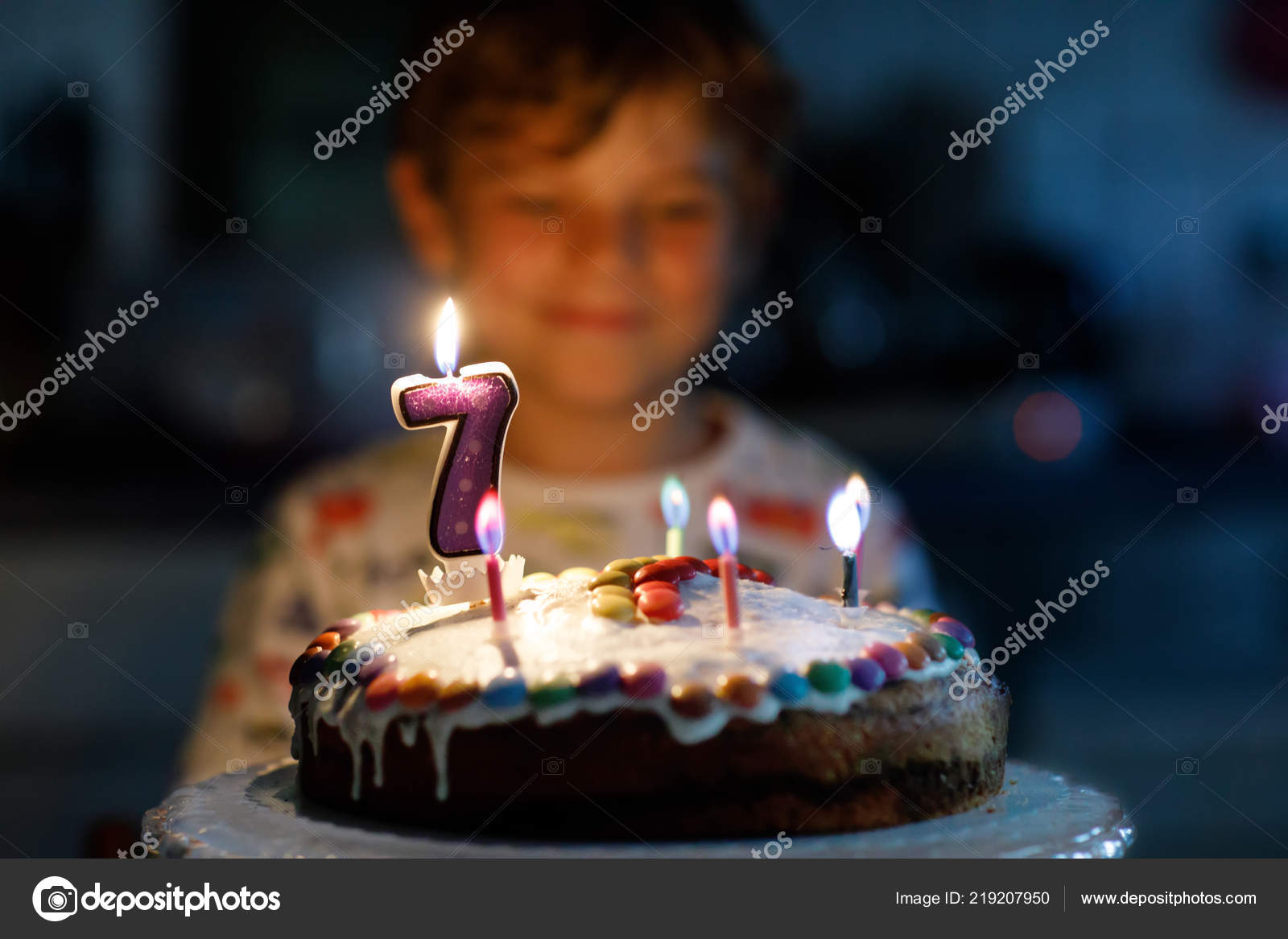 Adorable Happy Blond Little Kid Boy Celebrating His Birthday Child Blowing Seven Candles On Homemade Baked Cake Indoor Party For School Children