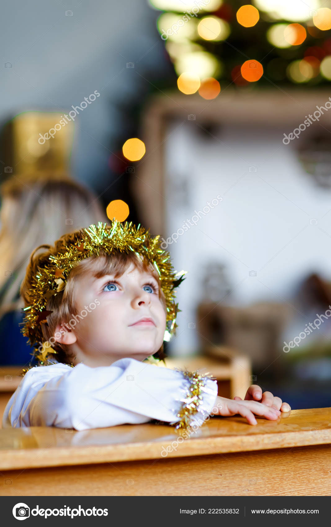 Beautiful little kid boy playing an angel in Christmas story in a ...