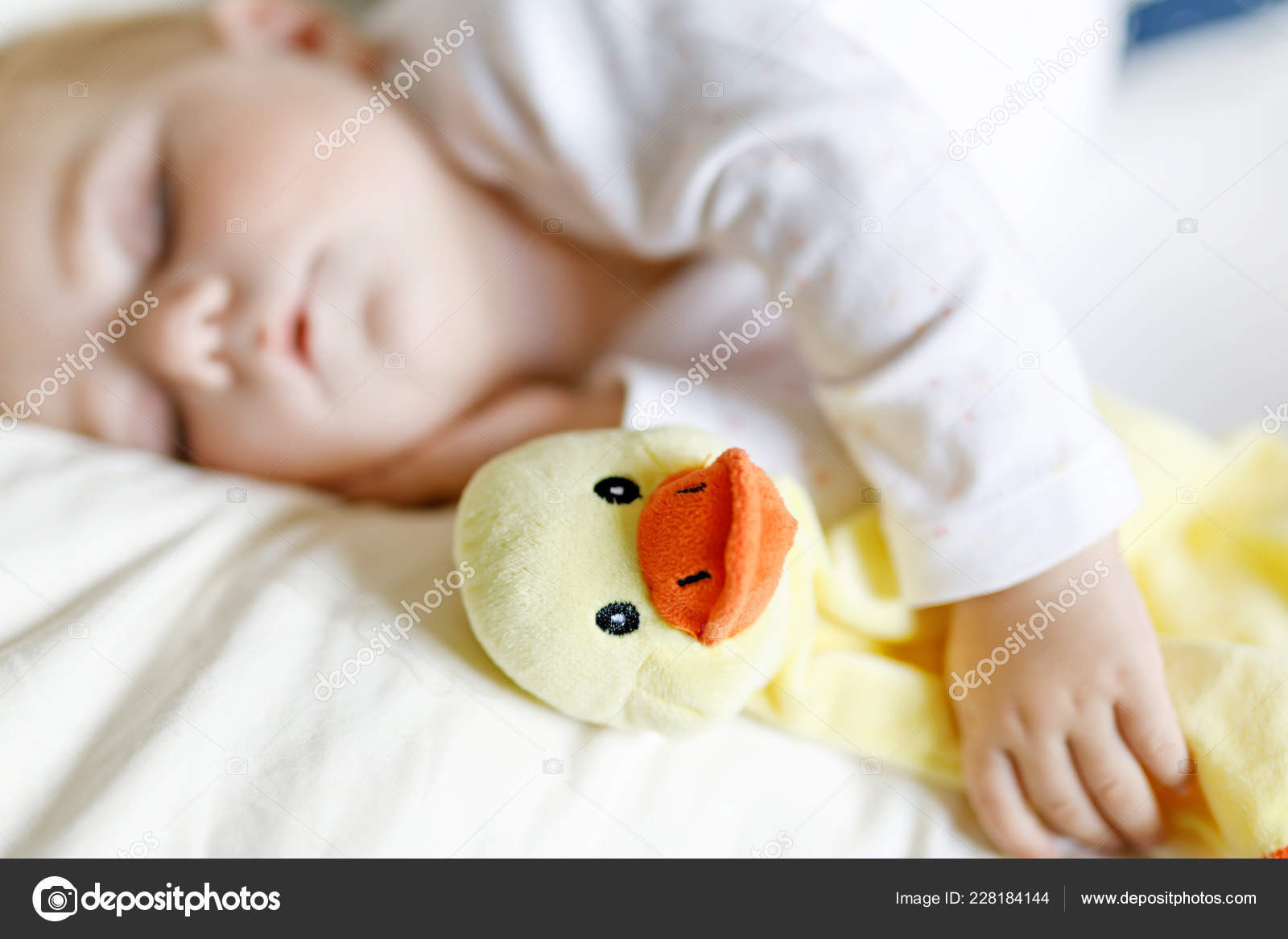 Cute Adorable Baby Girl Of 6 Months Sleeping Peaceful In Bed At Home Closeup Of Beautiful Calm Child Little Newborn Kid Sleeping With Plush Toy Duck Stock Photo C Romrodinka 228184144