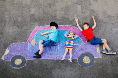 Three little children, two school kids boys and toddler girl having fun with with car picture drawing with colorful chalks on asphalt. Siblings painting on ground playing together. Creative leisure. stock vector