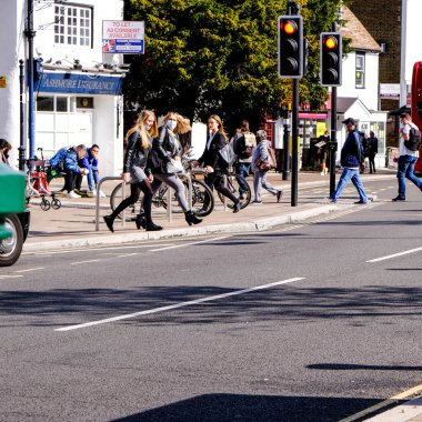 London UK, September 28 2020, Group Of Young People Crossing Road At Traffic Lights COVID-19