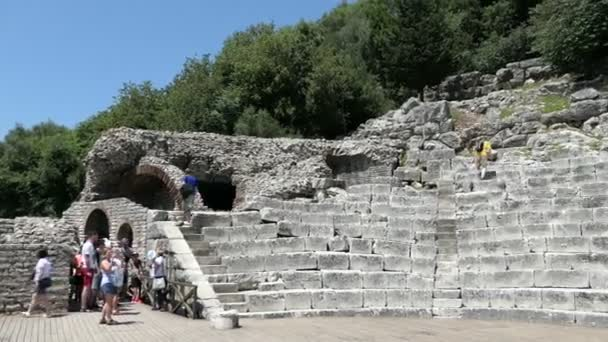 Buthrotum, Vlora / ALBANIA May 29 2018: People visiting ruins of amphitheater in Buthrotum (Albania) of roman and venetian time.  Archaeological park. Also known as Butrint and Butrinti.