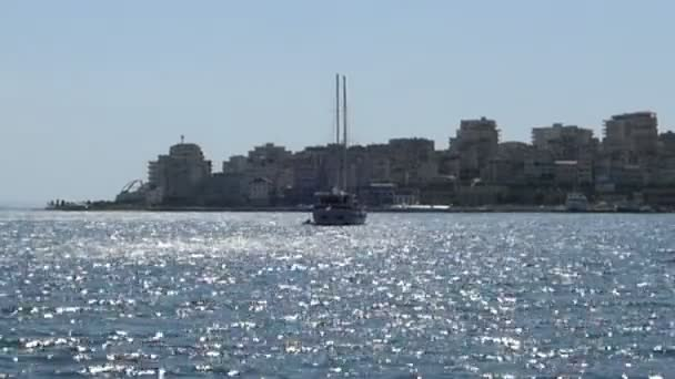 boat in front of the cityscape of Saranda (Albania). Balkan riviera.