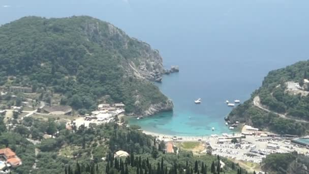 Aerial view from Lakones down to town and bay of Paleokastritsa and Paradise beach at Liapades (Corfu Island, Greece).