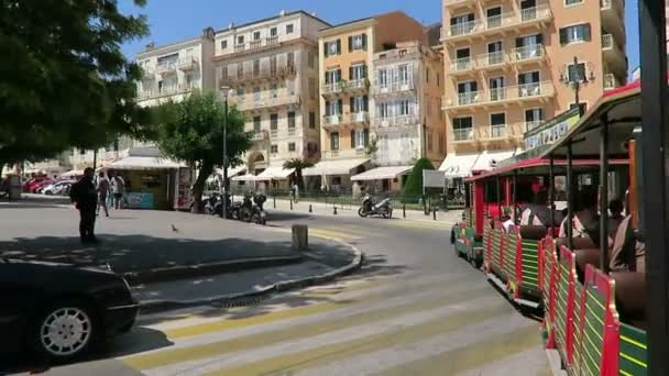 Corfu town, Corfu / GREECE June 01 2018: Cityscape of Corfu Town (Greece) with traditional houses and streets. Driving with a city train around, passing by restaurants and stores.
