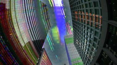 tokyo city skyline scene with data and computer programming information mapped onto each building face