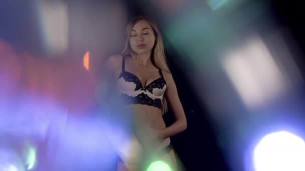 Amazing young woman in lingerie posing and dancing