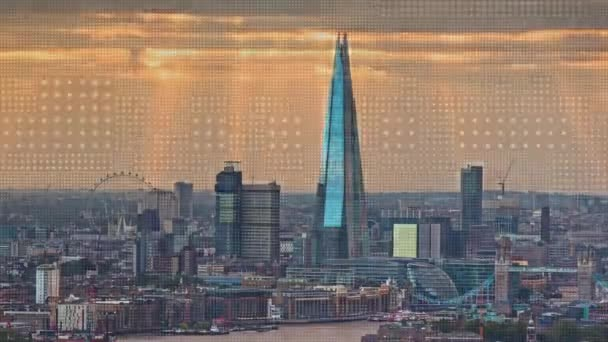 a sunset timelapse of the city of london skyscrapers. amazing sunrays are captured during this scene. this version has overlayed motion graphics and effect