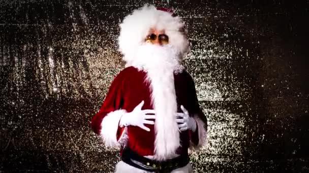 Santa Claus v sluneční brýle taneční party na zlaté pozadí