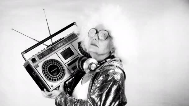 amazing grandma DJ, older lady with a ghettoblaster, partying in a disco setting