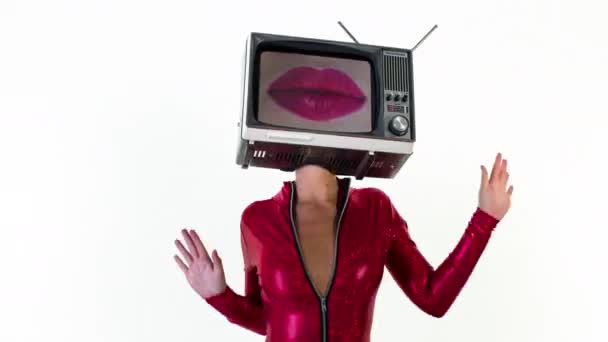 Amazing woman dancing with television as head, tv has video of moving lips