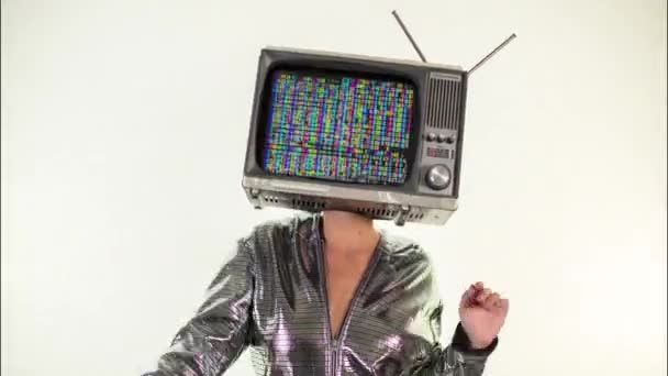 amazing woman dancing and posing with a television as a head. the tv is has data and code playing on it