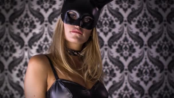 Sexy woman dancing with large bunny ears mask and black latex body