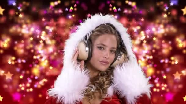 Woman dancing in Santa Claus costume and headphones on red background