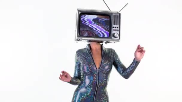 amazing woman dancing and posing with a television as a head. the tv has static and distorted video on it