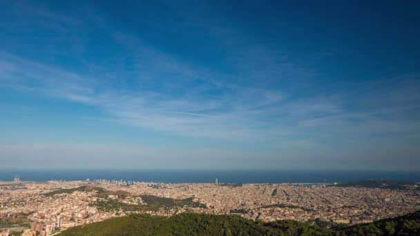 panning timelapse of the barcelona city skyline in the afternoon with beautiful light