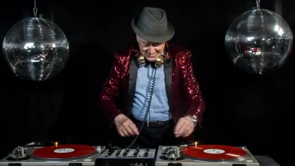 amazing grandpa DJ, older man djing and partying in a disco setting