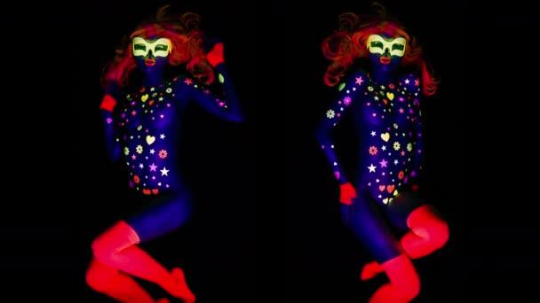 Amazing female in luminescence light posing on black background