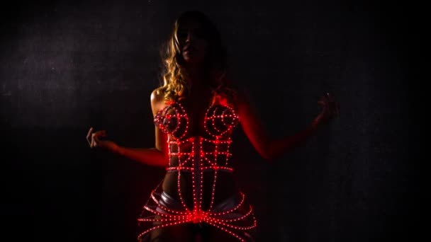beautiful sexy female dancer in amazing led light corset in a disco setting