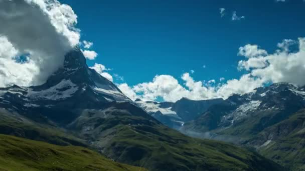 Timelapse of Matterhorn and surrounding mountains in Swiss Alps with cloud formations