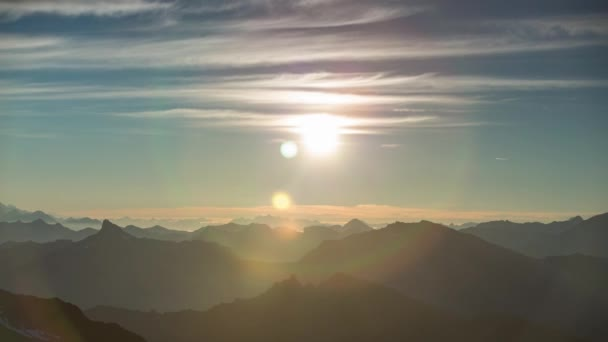 stunning time lapse in the early morning as the sun rises over the mountain peaks from the mont fort viewing point in verbier, swiss alps