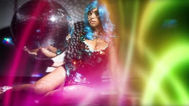 beautiful female in amazing glittering costume