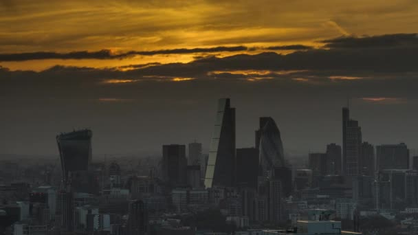 sunset time lapse of the city of london skyscapers. amazing sunrays are captured during this scene