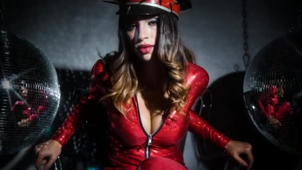 sexy cool latina woman posing in amazing red catsuit with spiked military hat and vintage ghetto blaster