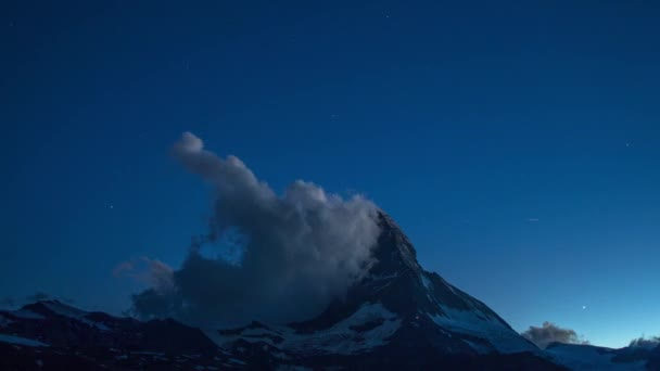 nighttime star time lapse of the amazing matterhorn mountain in the Swiss Alps