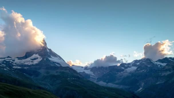 sunset timelapse of the amazing matterhorn mountain in the Swiss Alps with fantastic cloud formations