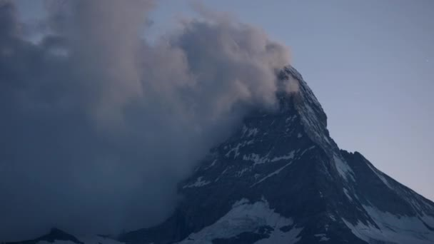 zooming time lapse of the amazing matterhorn and surrounding mountains in the Swiss Alps with fantastic cloud formations
