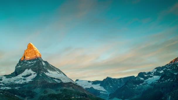 dawn, sunrise time lapse of the amazing matterhorn mountain in the Swiss Alps. the sky lights up in an incredible display of colour followed by the shadow lowering over the mountain