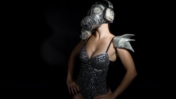 amazing woman dancing in diamond covered gas mask and costume