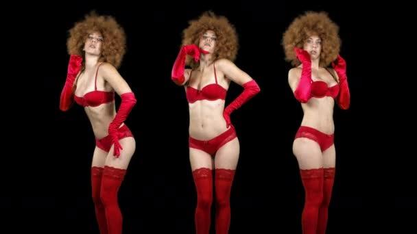 Gyönyörű női táncos a vörös fehérnemű, és nagy afro paróka