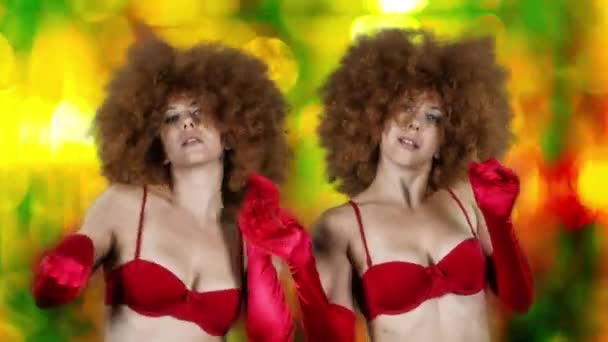 Beautiful female dancer in red lingerie and large afro wig