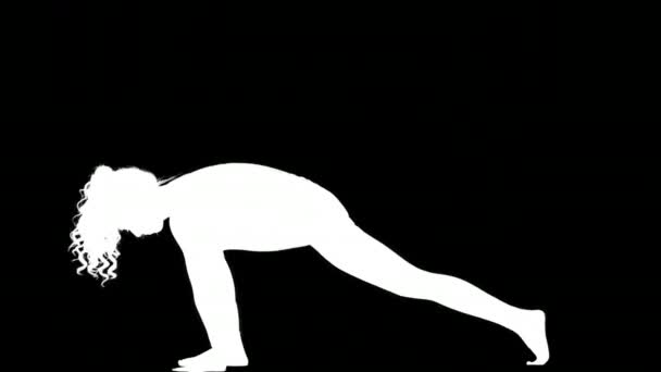 Silhouette of female doing yoga on black background