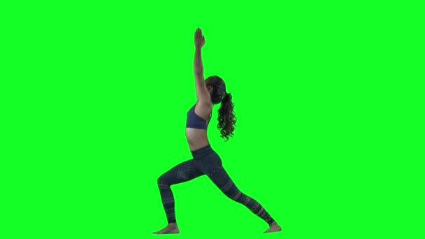 Young woman doing yoga on green background