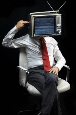smart businessman with television on head shooting himself in the head with his fingers