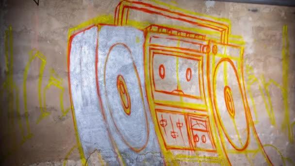 Process of painting boombox graffiti on wall
